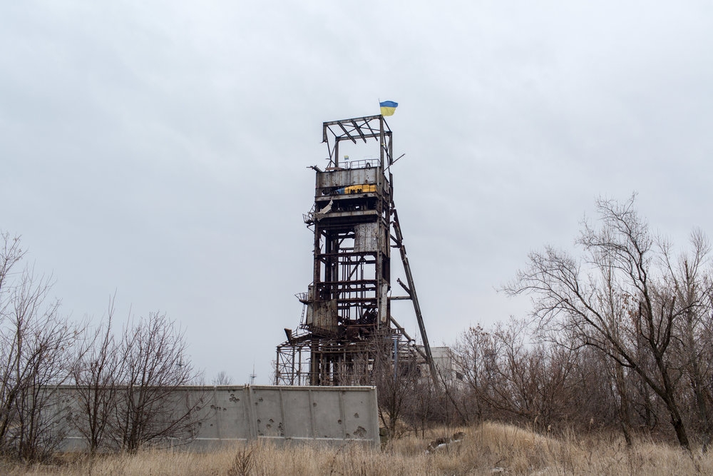 """This structure is one of the tallest, most prominent points in the immediate area of Pisky. Following fighting for the town, Ukrainian soldiers climbed to the top and let the blue and yellow flag fly. """"Separatists started shooting at them when they saw it,"""" one Ukrainian soldier told me, """"they didn't like it,"""" he finished, while laughing."""