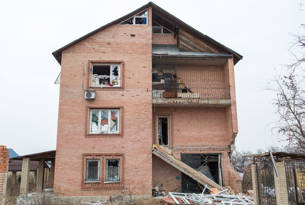 Civilian structures rapidly became military positions. Where people may have looked at scenic views, sandbags, broken windows, and machine gun nests remain. Like many of the taller houses and buildings in Pisky, the walls of this building are sprayed with damage from shrapnel and rocket attacks.