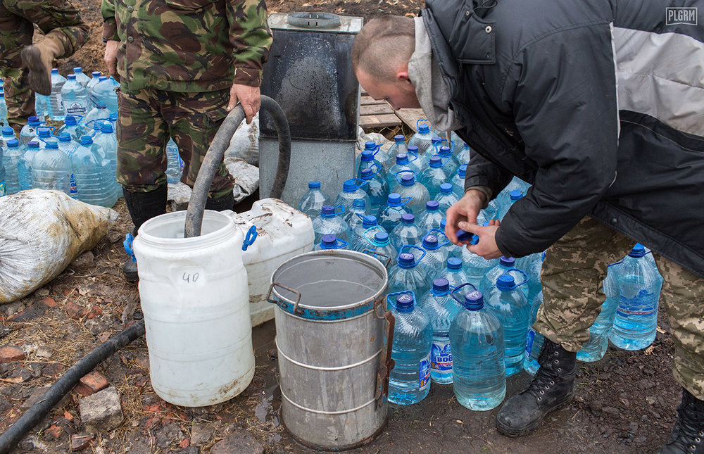 Water is delivered by truck to front lines in Donetsk. You see water as much more of a privilege and precious resource when you understand the difficulties that come with transporting it to places like this position outside of Pisky.