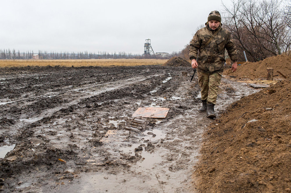 Constant rain makes life difficult in Donetsk. Mud builds up everywhere, making walking a task that involves balance and patience.