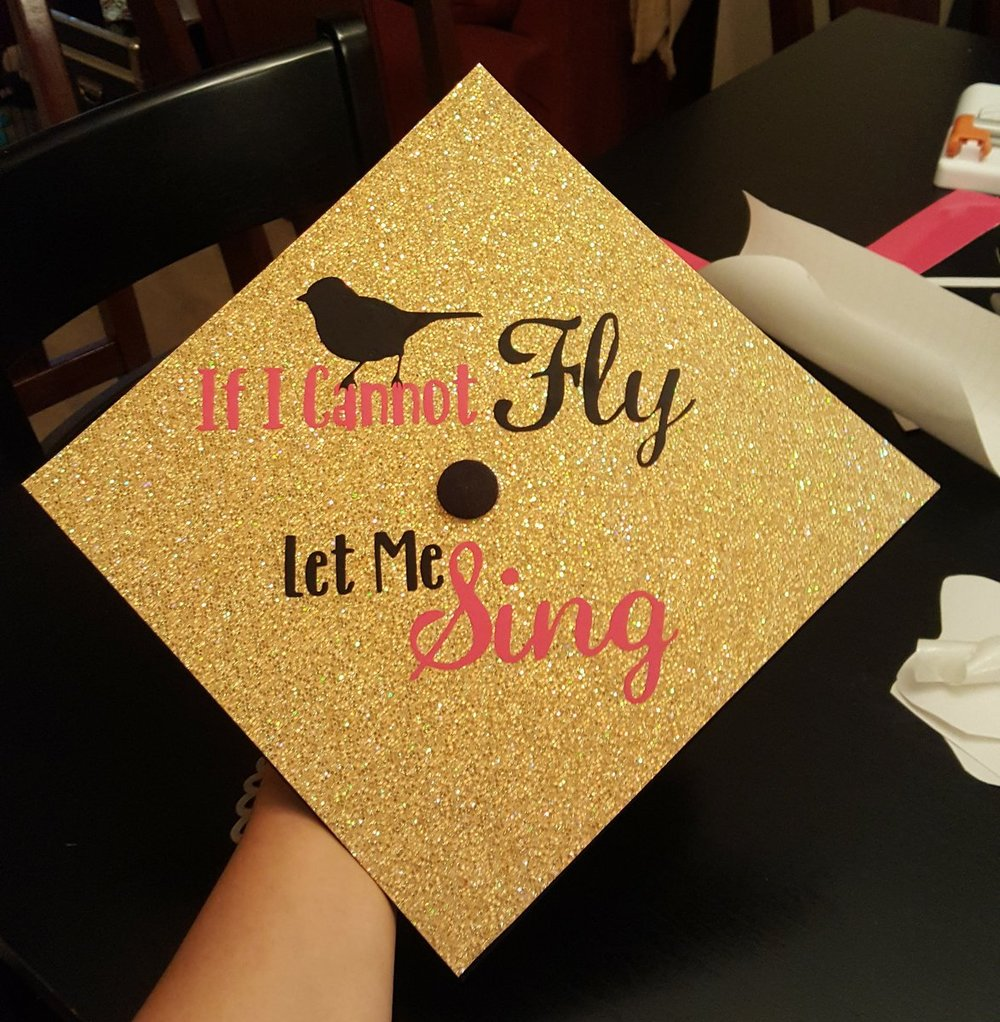 Sophia   I made this grad cap for one of my best friend's. She is a singer and wanted that to be the main message of her cap. Not pictured are the pink wings I added later to the sides of it to add some extra character.