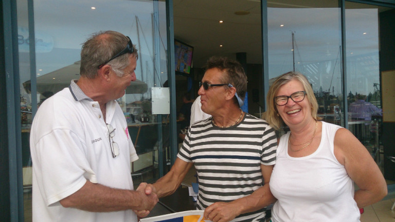 Allen & Sue Pick accept the SCYC burgee from Commodore Ian Brownhill.jpeg