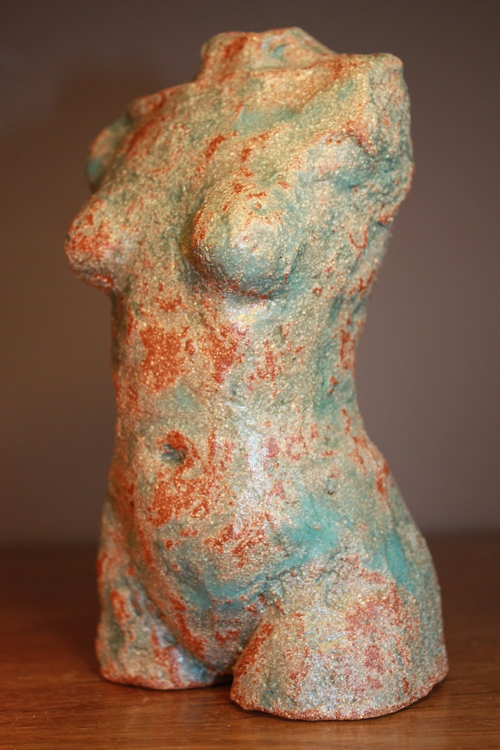 Copy of Ceramic torso fired with vibrant glazes.