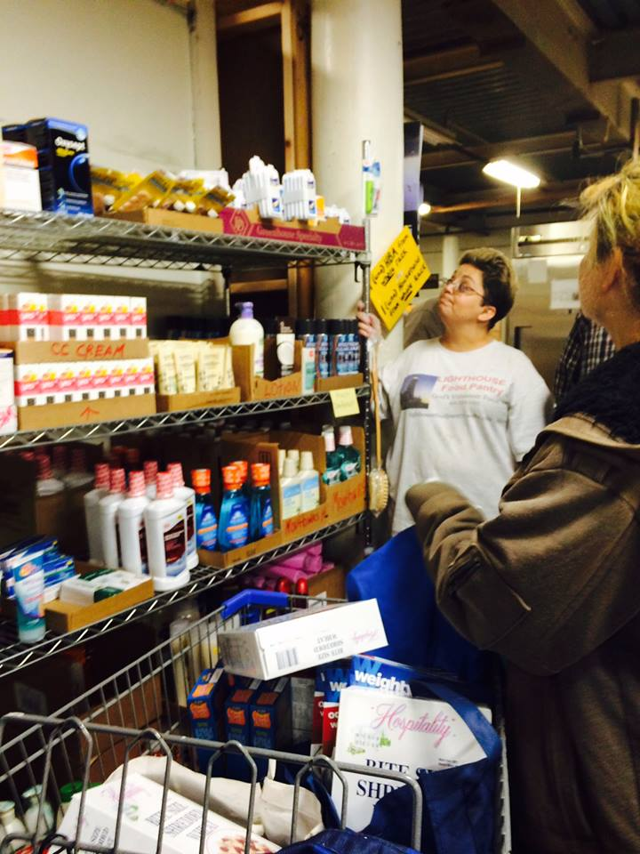Brenda Pugsley, Certified Food Safety Manager at  Lighthouse Community Food Pantry , helping a customer during Thanksgiving Distribution, 2016.