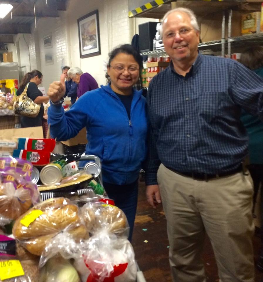 Pastor John Feragne, Director of the Food Pantry, with a Food Pantry volunteer during the Thanksgiving season.
