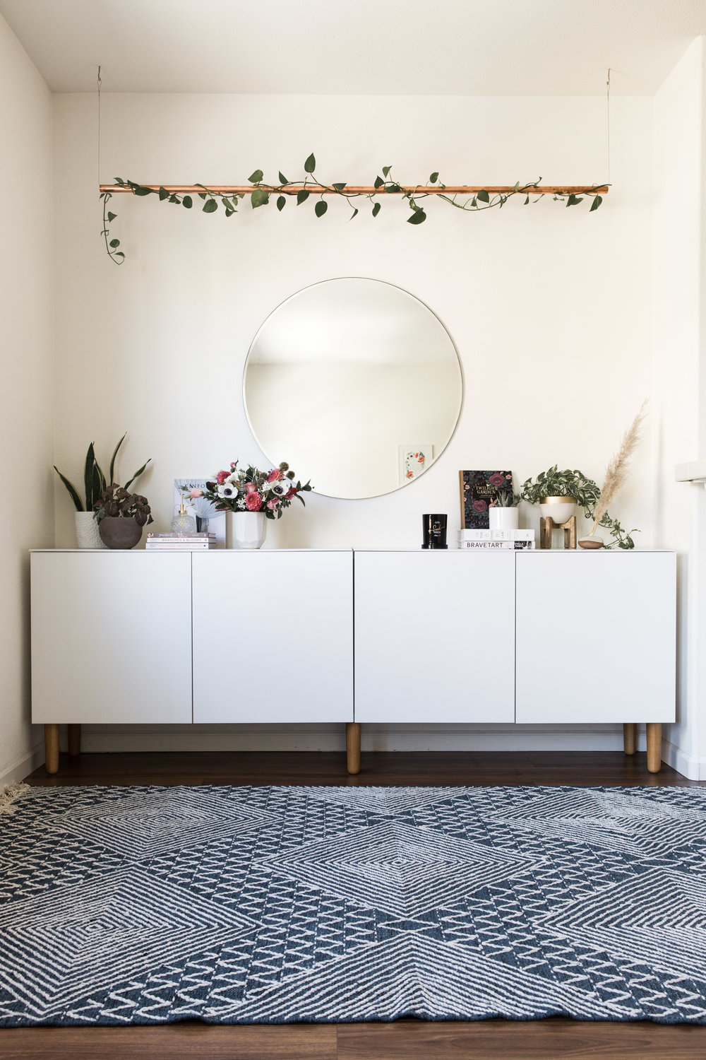 storage unit     |  rug (discontinued from west elm)  |  mirror (discontinued from west elm)