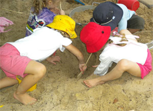 Sand-play-with-hats-small.jpg