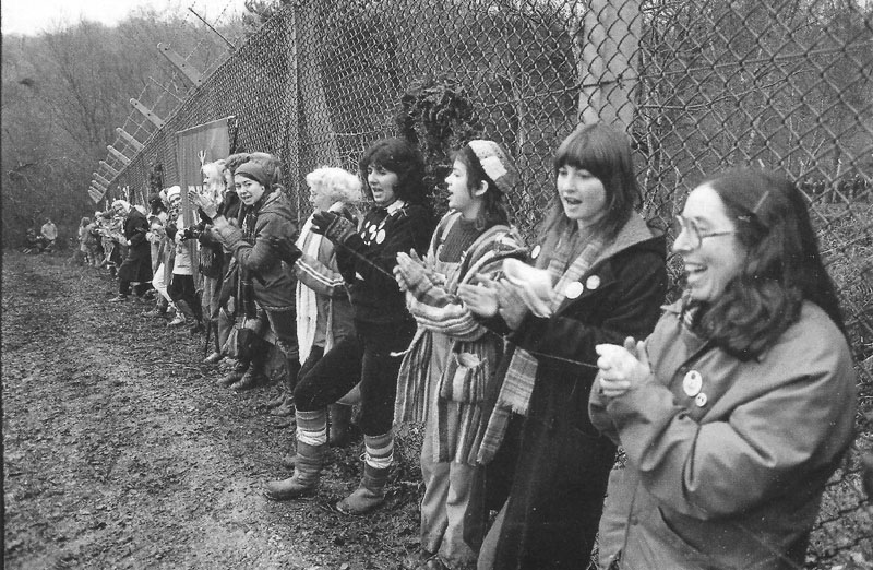 women along the fence.jpg