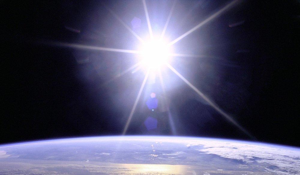 full_sunburst_over_earth.jpg