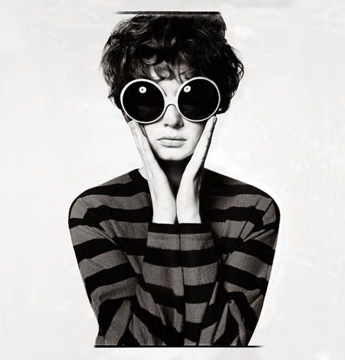 model wears striped jumper and oversized circular sunglasses