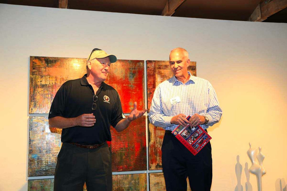 Bob Jenkins and Kirk Tushaus speaking at Jon Mirmelli's client appreciation event following the golf tournament