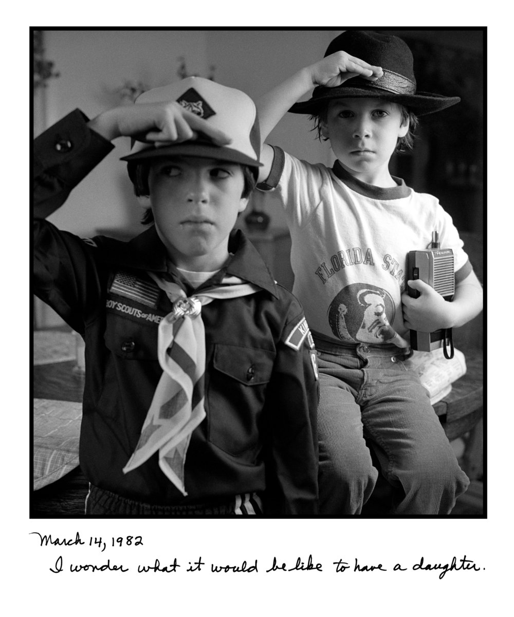 Judy Gelles,  Jason & David Saluting , 1982  Silver gelatin print with handwritten notes (original); digital pigment print, 20 x 24 in, edition of 5   Inquire