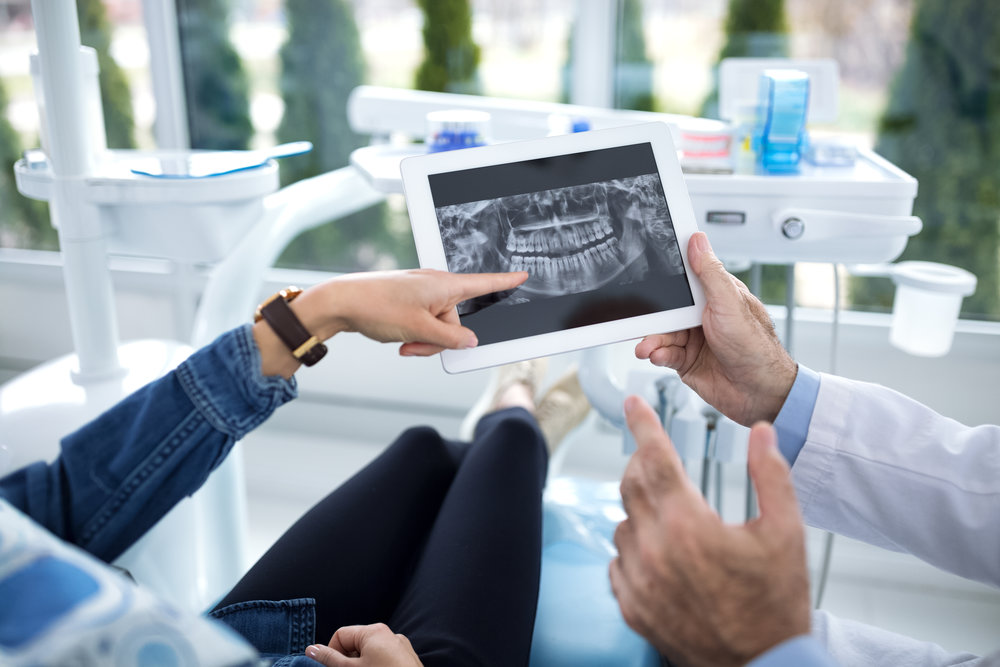 bigstock-The-Patient-And-Dentist-Are-Co-228895234.jpg
