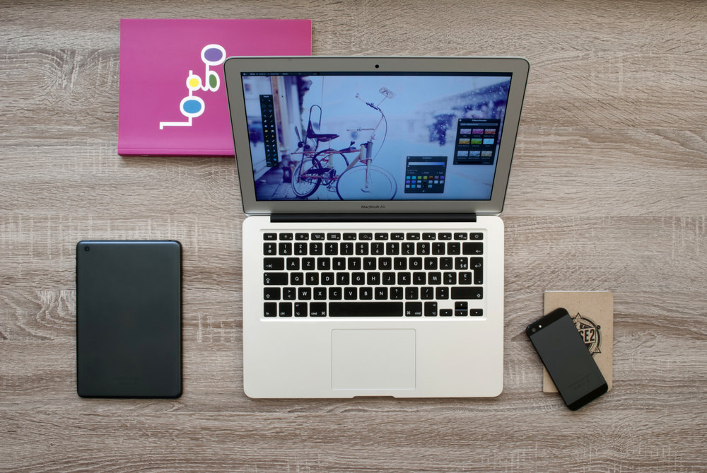 laptop-computer-with-tablet-and-smartphone-on-the-sides.jpg