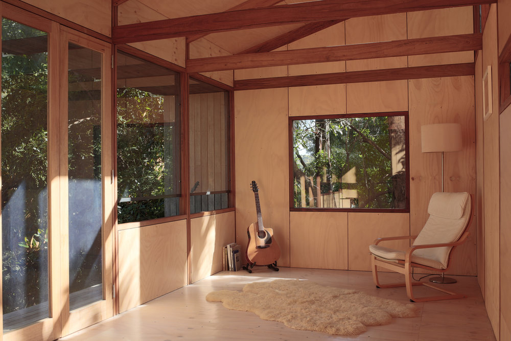 The possible use as a lounge room demonstrates the spatial capabilities of the building model just after it was reassembled in Thirroul and before the studio joinery was installed.