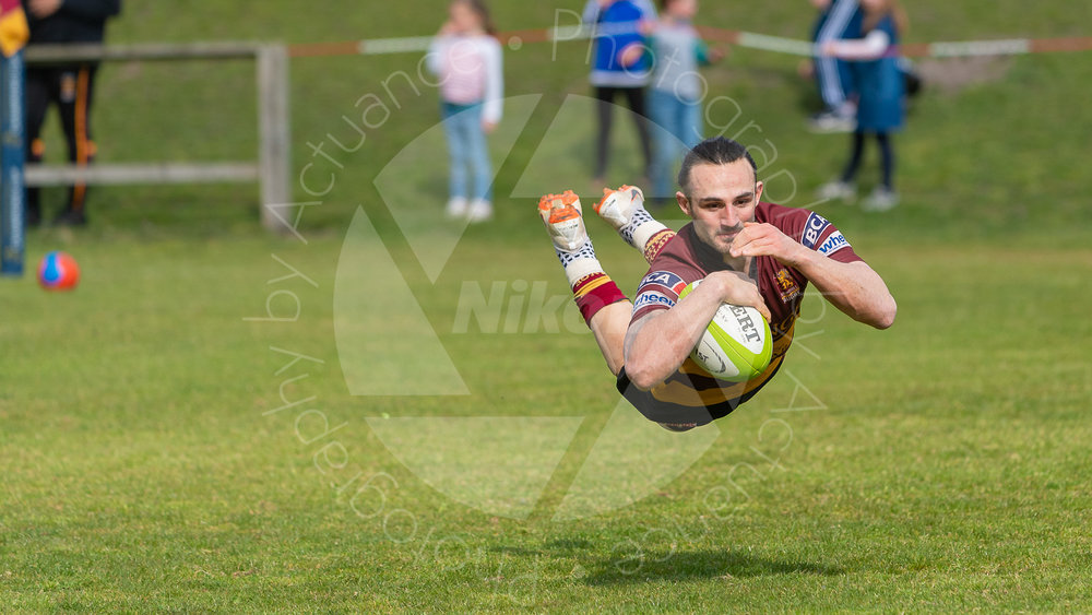 Sam Baker  literally flying to provide Ampthill with even more points! (Photo: Iain Frankish, Actuance Photography)