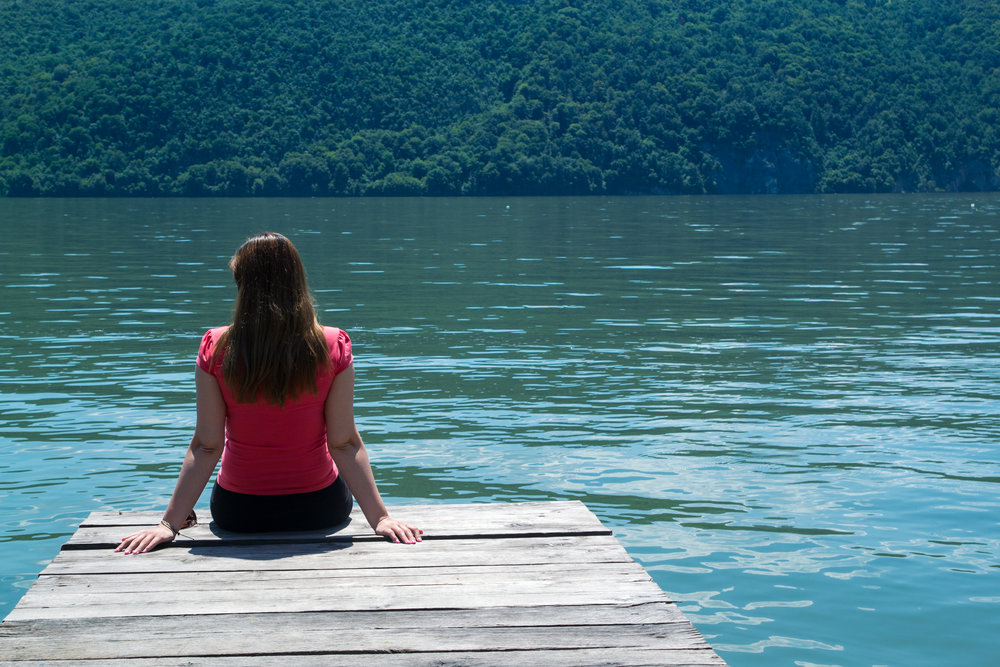 A young woman in red blouse sitting on a pontoon..jpg