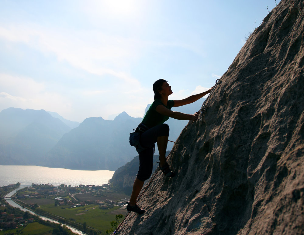 Silhouette of a female rock climber against picturesque view of Lake Garda copy.jpg