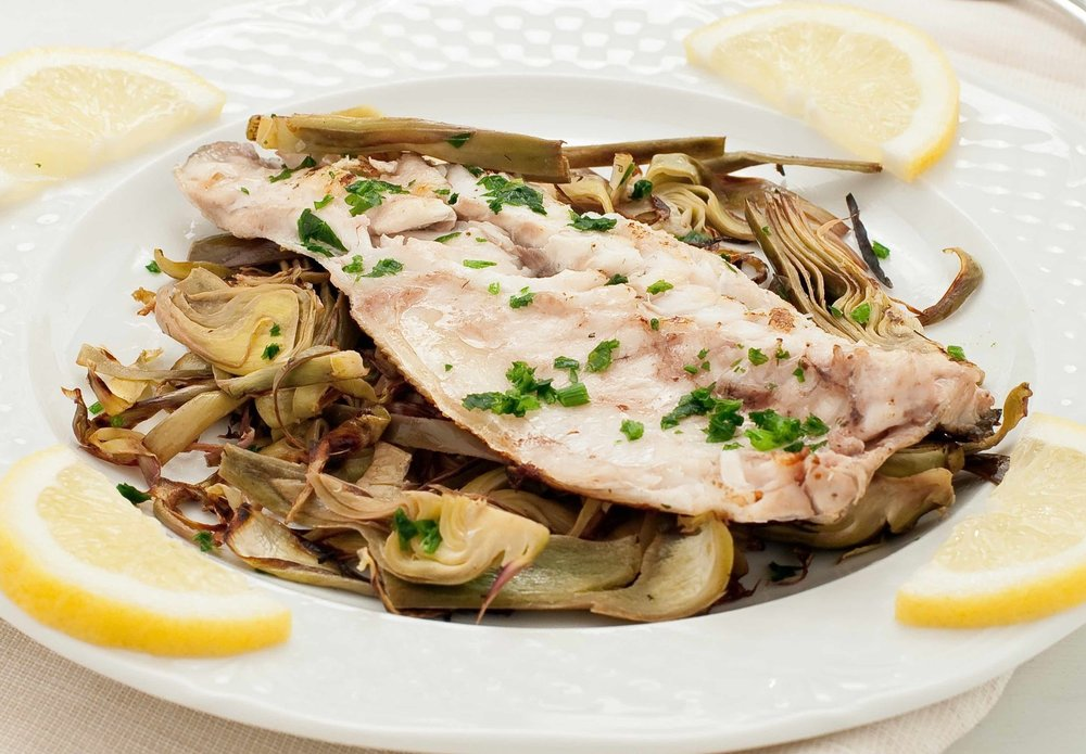 Fish sea bass cooked in a pan with the artichokes copy.jpg