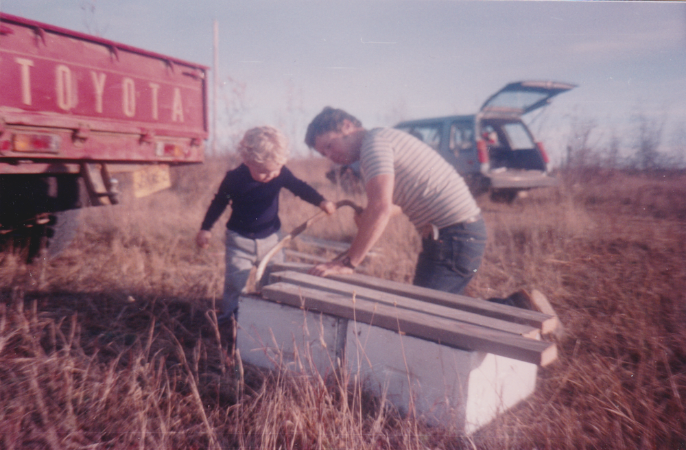 Mike and his dad with some bees.