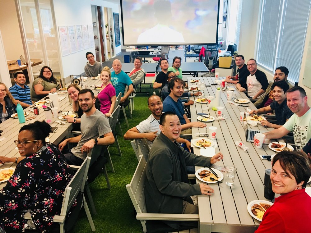 Call-Em-All team shares a weekly lunch together before they go over their company-wide metrics.