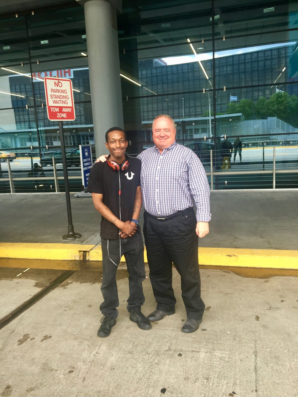 Vontae and Tom smile for a picture before dropping me off at the airport.