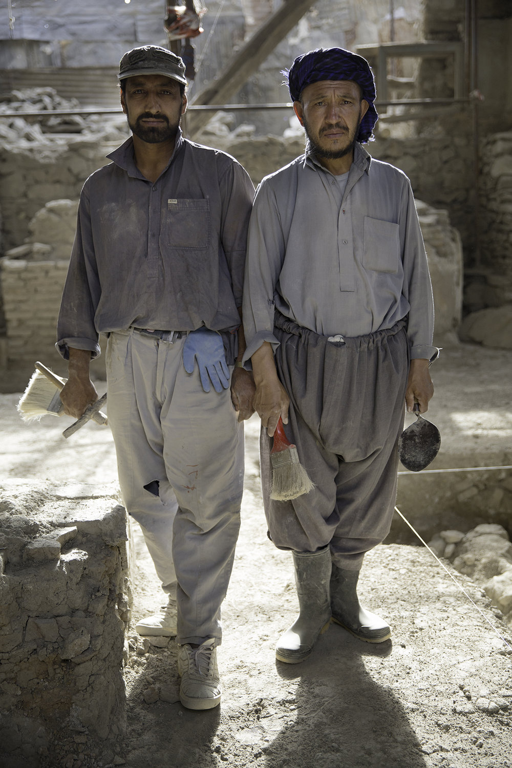 Two laborers pose for a picture during restoration and preservation work of Gudri Mosque in Kabul, Afghanistan.