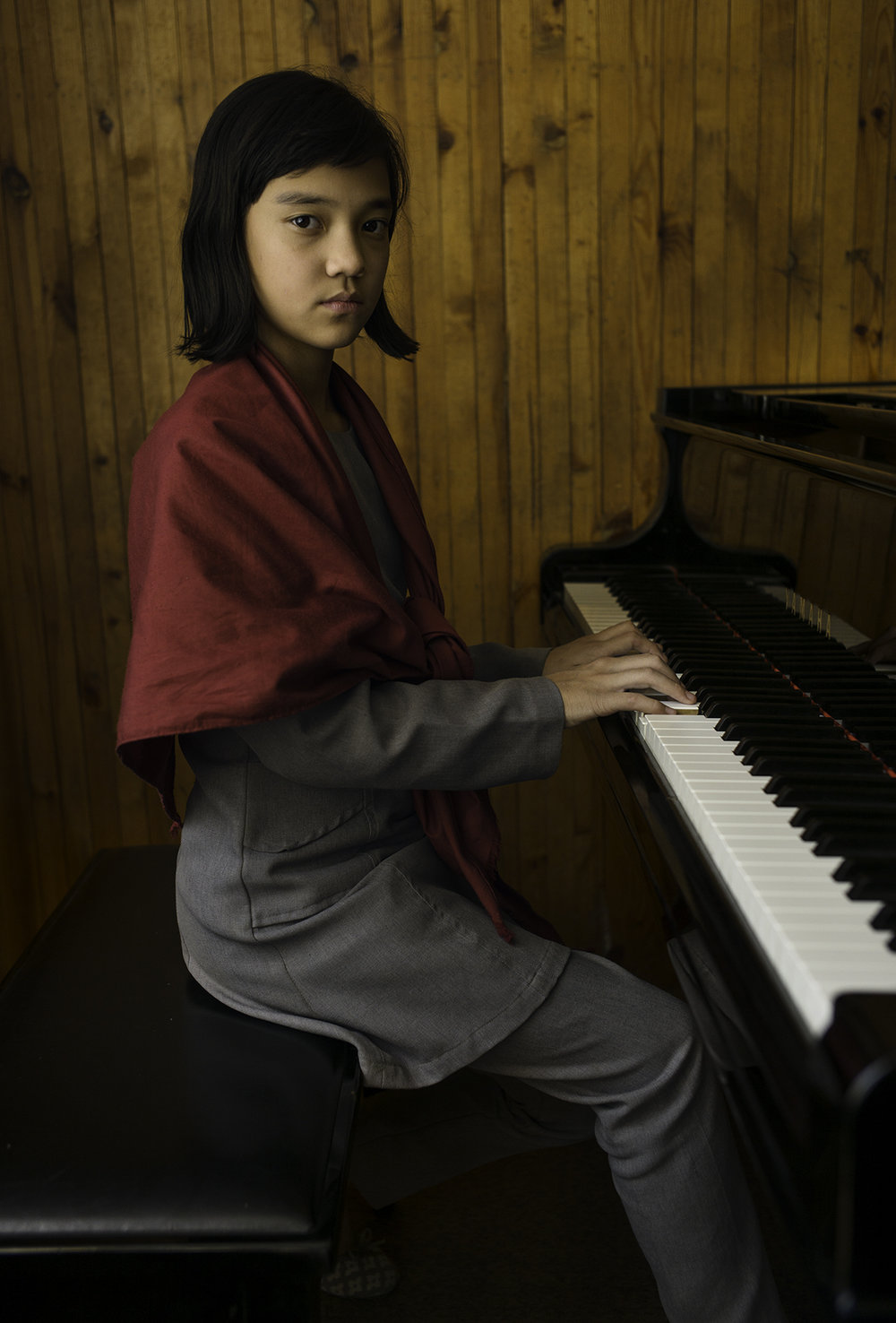 A seventh-grade pianist poses before resuming her practice at the Afghan National Institute of Music in Kabul.