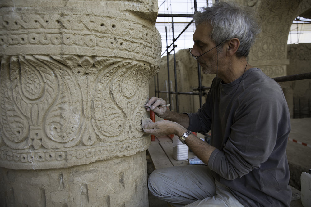Daniel Ibled, a member of the project's restoration team, works to reveal and consolidate the ornamentation at Noh Gunbad in Balkh.