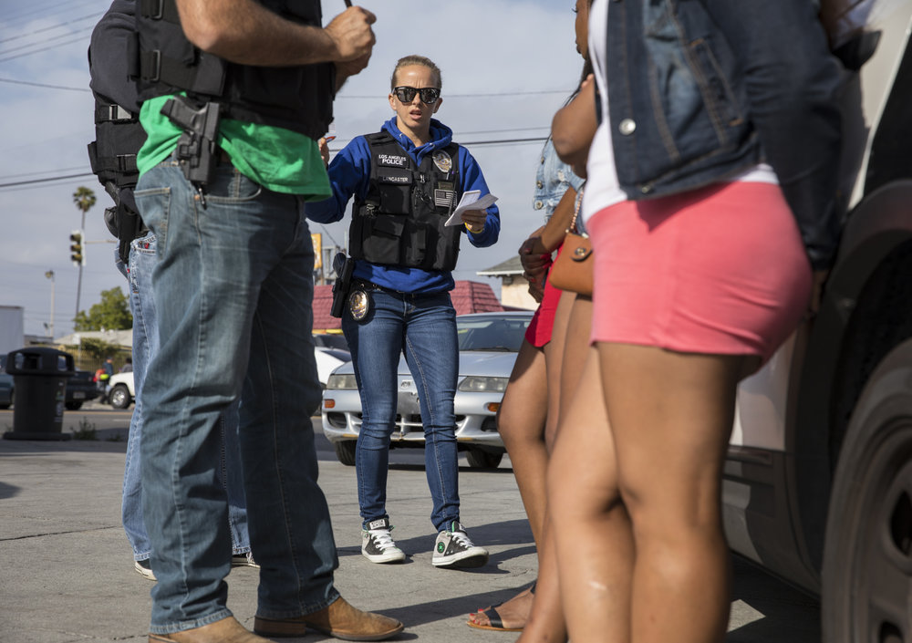 May 16, 2017: Officers of the Los Angeles Police Department's Vice Squad confront three women in the southeast area of Los Angeles, California, issuing them warnings for loitering for the purposes of prostitution - a municipal code violation.