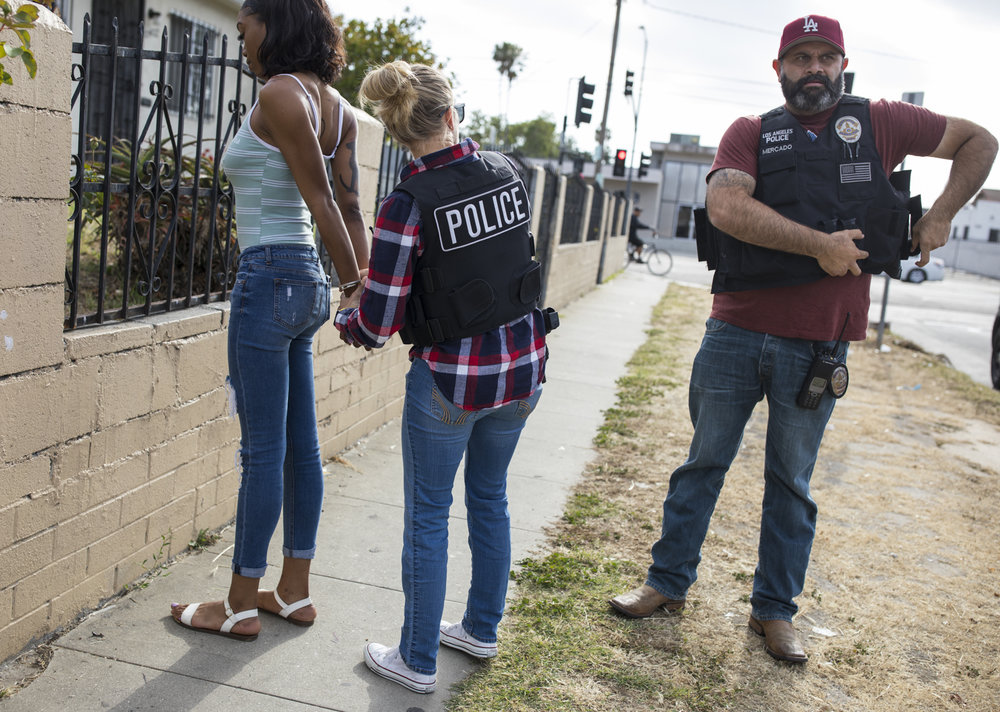 May 17, 2017: Officers of the Los Angeles Police Department's Vice Squad arrest a 17-year old woman in the south east area of Los Angeles, California for soliciting an undercover police officer for the purpose of prostitution.