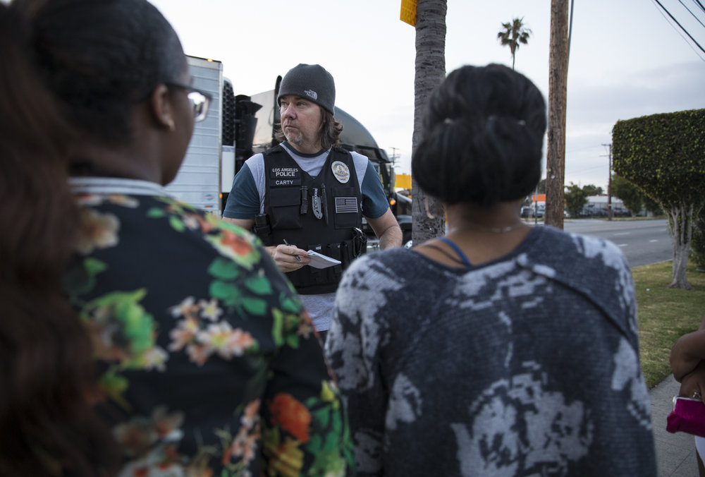 May 18, 2017: Sgt Scott Carty, center, an officer with the Los Angeles Police Department's vice squad, arrests three  women in the southeast area of Los Angeles, California for soliciting undercover police officers for the purpose of prostitution. On this morning, thirteen women were arrested in 30 minutes, starting at 5:35am, along Figueroa Street - a renowned thoroughfare for prostitution.