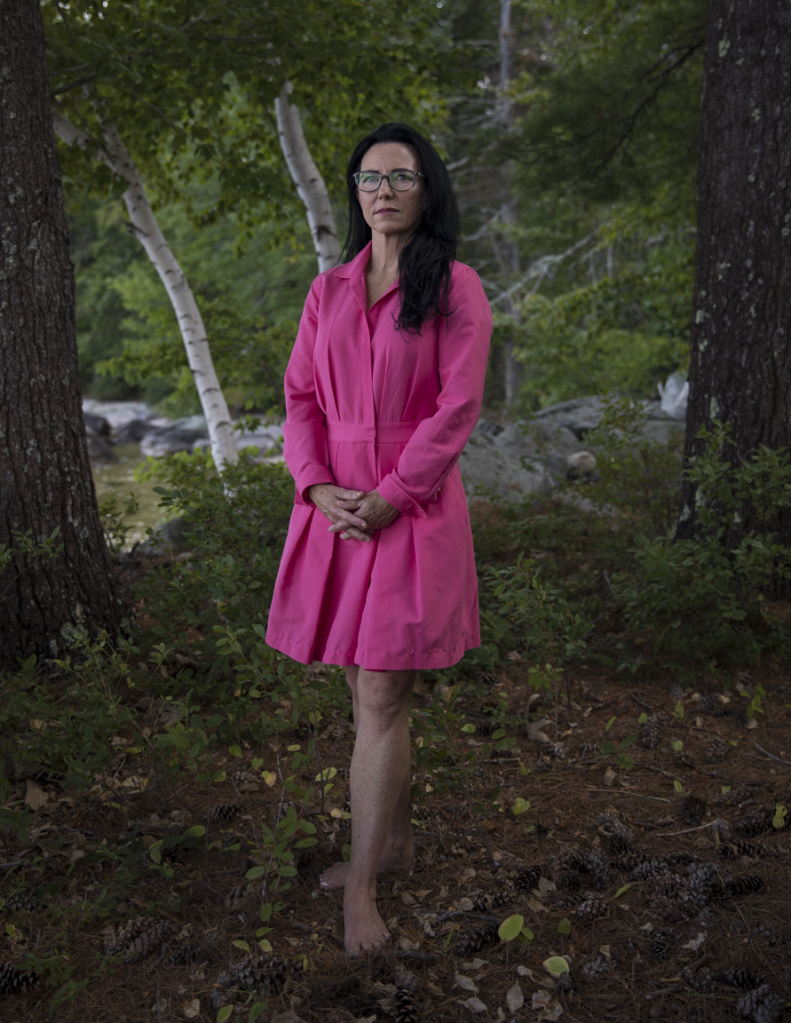 Catherine Ann Wilson stands outside her home on Sebago Lake, Maine on August 26, 2017 . Catherine is a sex trafficking survivor, now an anti-trafficking advocate and the founder-director of  stoptraffickingUS.org.