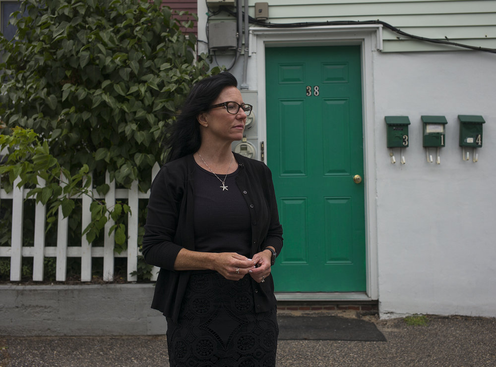 Catherine Ann Wilson stands in front of a friend's apartment in Biddeford, Maine in July 2016 where she ran away to 36-years ago from her home in Florida. Once inside, she was raped and trafficked by her friend's pimp whom she hadn't been told about and who threatened her life if she tried to escape. She did so one-year later.