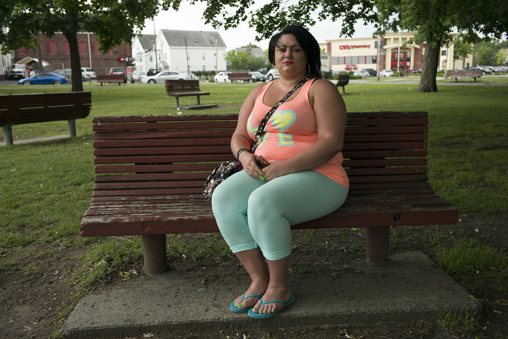 Candise Walker sits in the Lynn Commons Park in Lynn, Massachusetts in June 2016. Candise was sexually abused by her female babysitter when she was 5-years and raped by her mother's drug dealer when she was 12-years as payment for her mother's dose of crack cocaine.