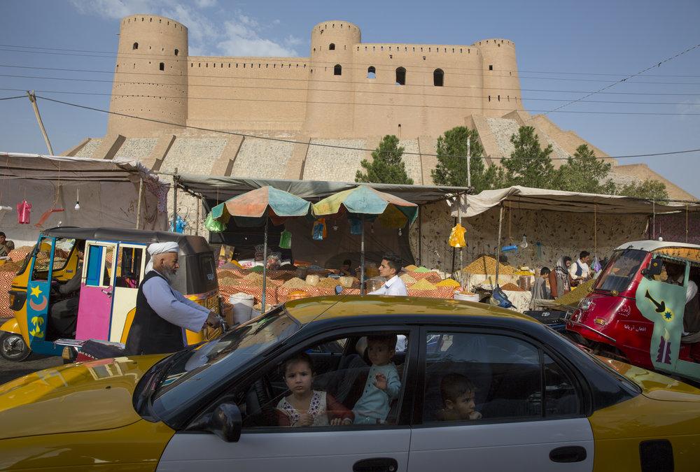 The Citadel towers over Herat's bazaar. September 2016