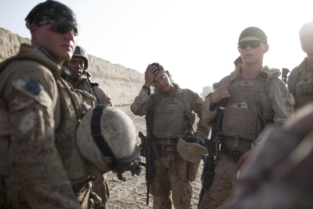 August 2009: U.S. Marines from the 2nd Light Armored Reconnaissance Battalion hold a briefing after a patrol in Khan Neshin, Helmand province. Taliban fighters, forced to flee by the influx of 4,000 Marines into the province, had controlled southern Helmand for nearly four years.