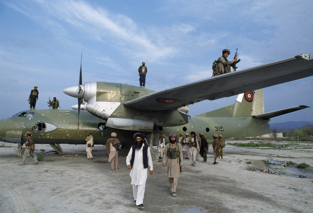 April 1991: Afghan mujahideen inspect a Kabul government plane after they seized the Khost garrison. Provincial control gave Afghan mujahideen, Arabs enlisted by Al Qaeda, and Pakistani advisors valuable territory to establish base camps for training and resupply in Afghanistan.