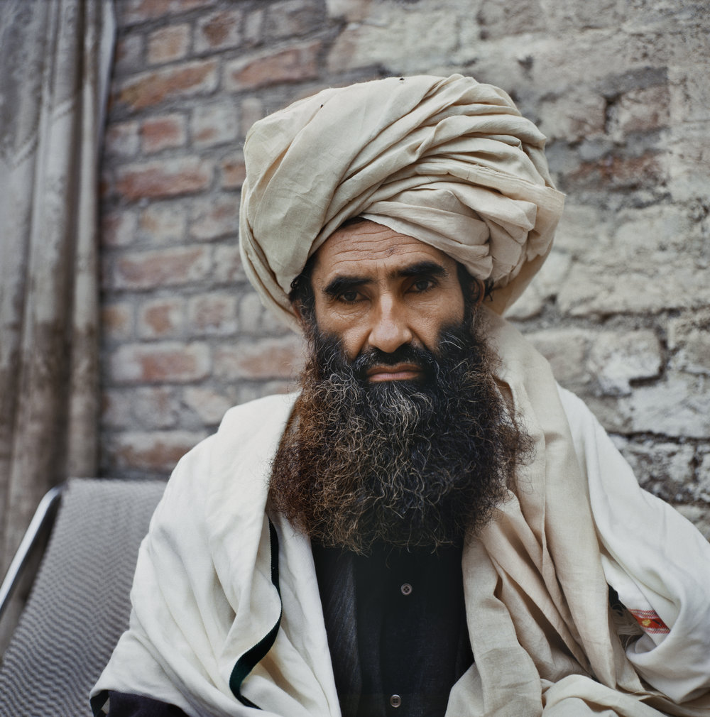 May 1990: Mujahideen commander Jalaluddin Haqqani at a base camp in Khost, Afghanistan. An ethnic Pashtun, Haqqani was an early convert to global jihad. Haqqani befriended Osama bin Laden in the late 1980's and attracted Arab fighters to his training camps along the Afghan-Pakistan border.