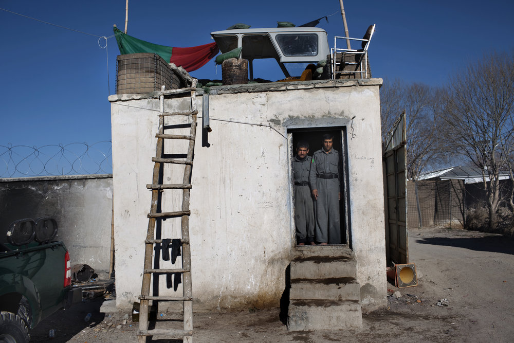 March 2009: Afghan National Police stand at a guard post in Qarabagh, Ghazni province. The Taliban controlled more than 40 of the 464 villages in Qarabagh district.