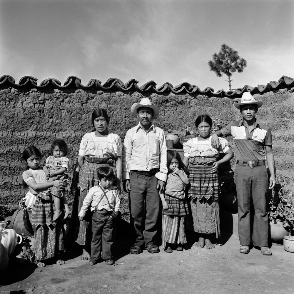 An extended Mayan family stands for a photograph May 1984 in the rural highlands of El Quiché, Guatemala.