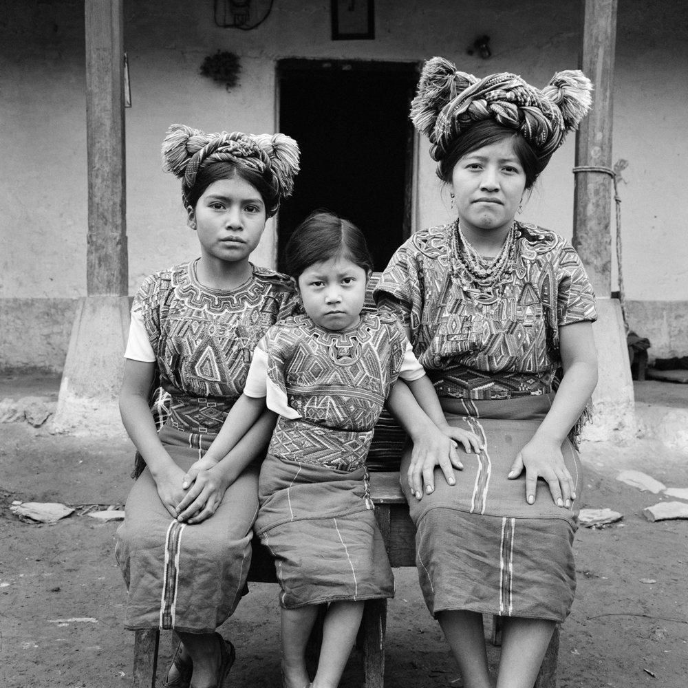 An Ixil Maya family, Josefa Cedillo Marcos, left, 13 years, Juana Cedillo Perez, center, 6 years, Josefa's niece, and Josefa's mother, right, sit for a picture in Nebaj, Guatemala, January 1, 1984.