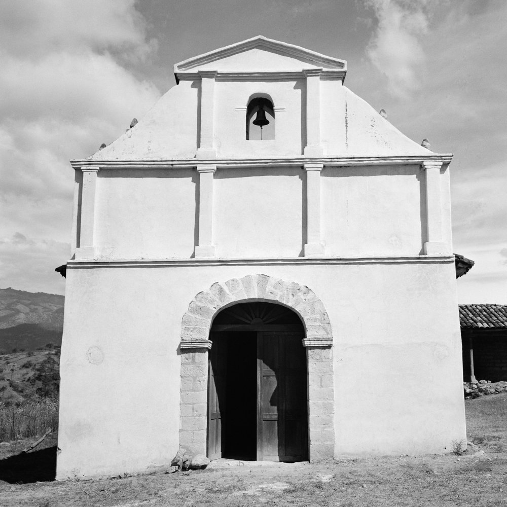 A stone Catholic Church stands January 1984 in a rural highland area of El Quiché province, Guatemala.
