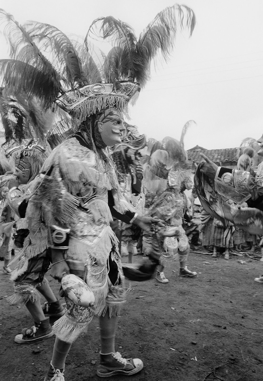 Local K'iche Maya residents reenact the Spanish conquest of the Americas at an event during the Fiesta de Santo Tomás, Chichicastenango, Guatemala, December 20, 1981. The seven day festival is a syncretism of Catholic traditions, honoring the city's patron saint Thomas, and native Maya traditions.