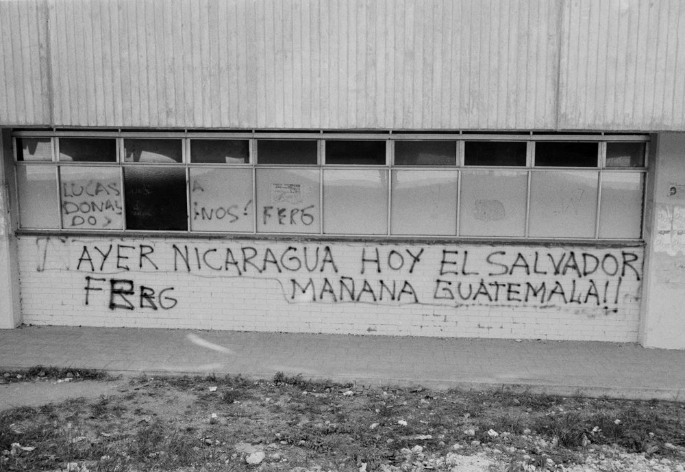 Graffiti in support of leftist insurgent groups and anti-government slogans collect on a wall March 1982 on the San Carlos University campus in Guatemala City, Guatemala.