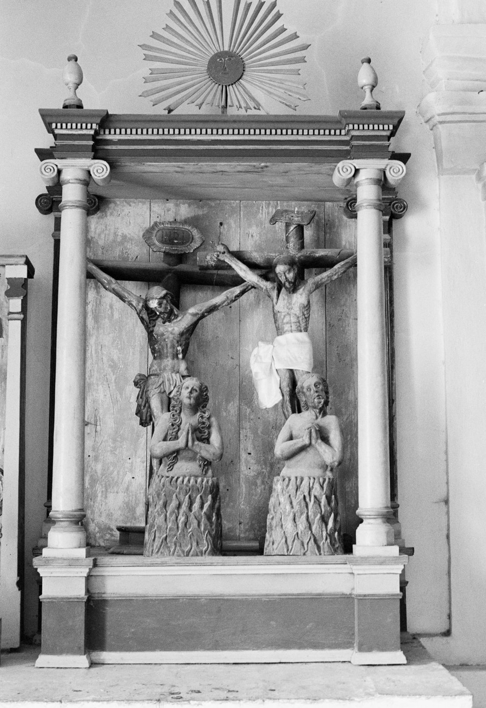 Wooden religious statues stand near the front altar of a Catholic church in Santa Cruz del Quiché, Guatemala, January 1, 1982.