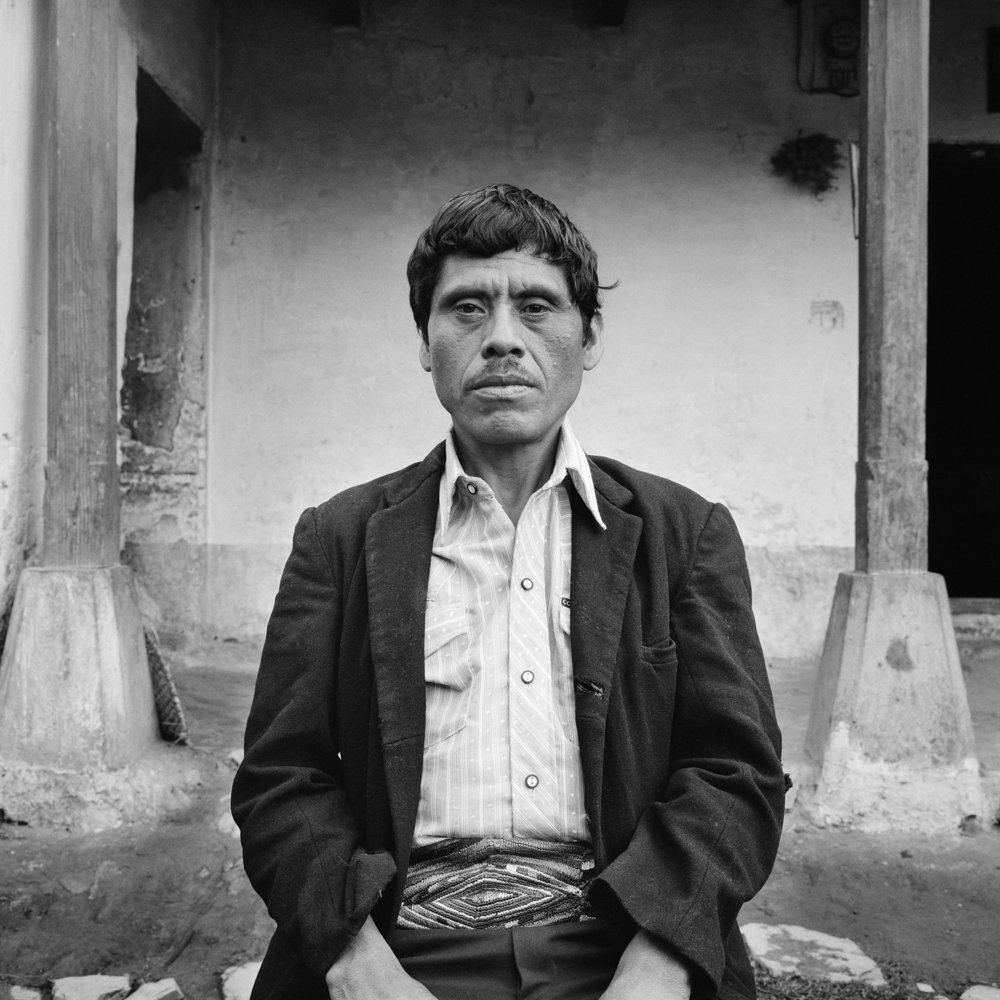 A man of Mayan decent sits for a picture in her home May 1984 in Nebaj, Guatemala. The Guatemalan army massacred many residents of the Ixil triangle, from Nebaj, Chajul and San Juan Cotzal, during the 1980's when the Guerrilla Army of the Poor, EGP, and other militant groups, fought a civil war with the Guatemalan Army in the highlands and cities of the country.