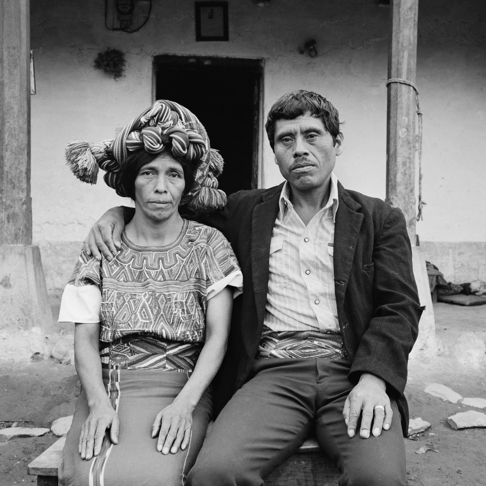 A married couple with the wife wearing a traditional Mayan head dress sits for a picture May 1984 in Nebaj, Guatemala.