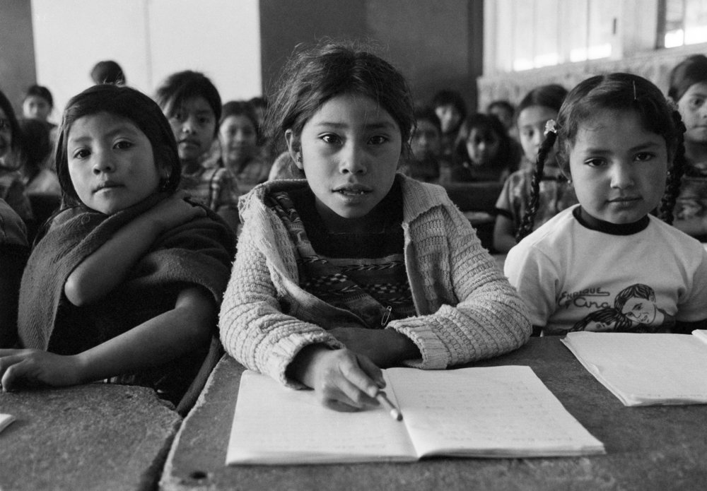 Schoolgirls sit in a classroom February 1, 1982 in Comalapa, Guatemala
