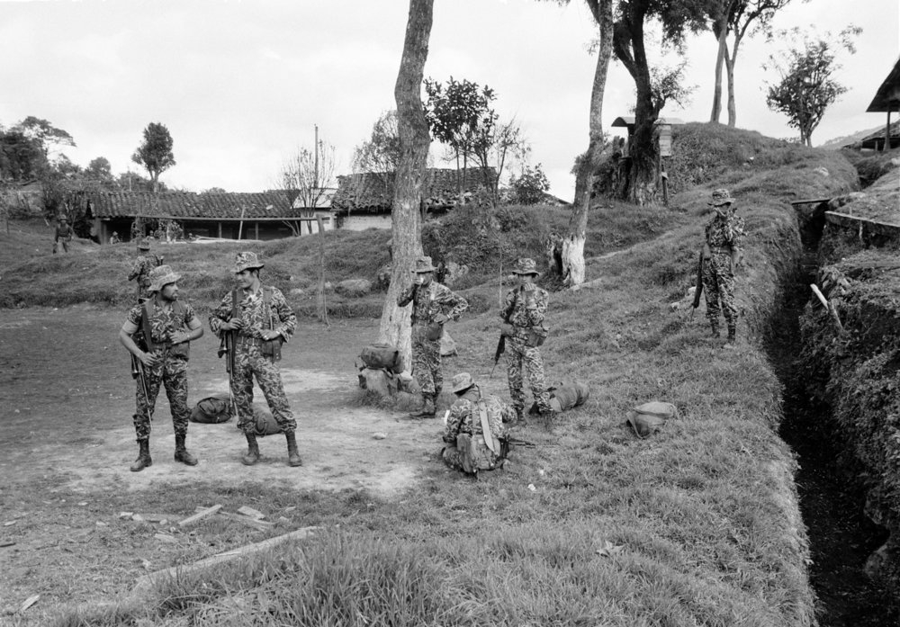 Guatemalan army soldiers stand in their base camp following a guerrilla attack a day earlier on January 19, 1982 in San Juan Cotzal, Guatemala. The Ixil Maya town and army were in turmoil after 300 leftist guerrillas from the Guerrilla Army of the Poor, EGP, attacked the government army camp leaving 37 government soldiers dead.
